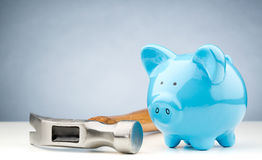 Hammer Lying Next to a Piggy Bank Stock Photography
