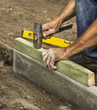 Hammer in male hands. On construction site stock photography