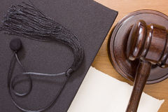 Hammer mallet and academic cap Royalty Free Stock Photos