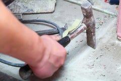 Hammer manual mason work floor tool Stock Photo