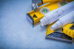 Hammer measuring tape blueprints construction Royalty Free Stock Photography
