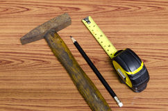 Hammer measuring tape and pencil Stock Photos