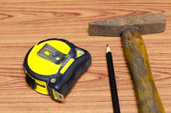 Hammer measuring tape and pencil Royalty Free Stock Image
