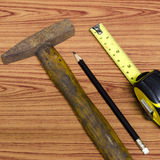 Hammer measuring tape and pencil Royalty Free Stock Photos