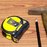 Hammer measuring tape and pencil Royalty Free Stock Images