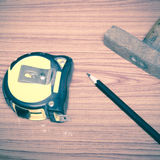 Hammer measuring tape and pencil Stock Photography