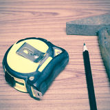 Hammer measuring tape and pencil Stock Images