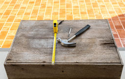 Hammer and Measuring Tape wood Royalty Free Stock Images