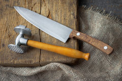 Hammer for meat and knife Stock Photos