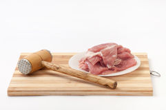 Hammer for meat and raw meat prepared for frying Royalty Free Stock Image
