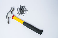Hammer and metal nails on a white background Stock Photos