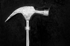 Hammer on a metallic background Royalty Free Stock Images