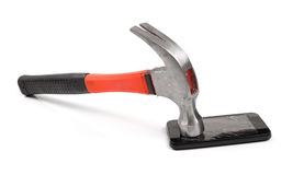 Hammer and mobile phone with broken display Stock Image