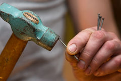 Hammer in a nail Stock Photo
