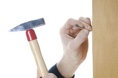 Hammer and nail. Two hands holding hammer and nail Royalty Free Stock Images
