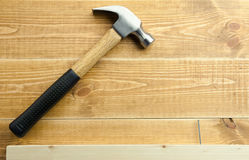 Hammer and nail. Are on a wooden planks Stock Photo