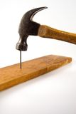 Hammer and Nail. Vintage Hammer Securing Wood by Driving a Nail stock images