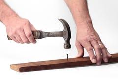 Hammer and nail. Hammer nail hand worker carpenter tool working Royalty Free Stock Photo