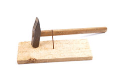 Hammer with nail and board Stock Photography