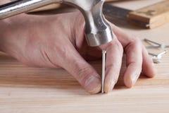Hammer and nail Stock Photos