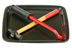 Hammer and nail drawer on a tray Royalty Free Stock Images