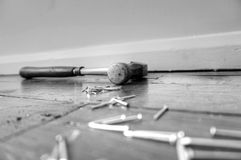 Hammer nail floorboard D Stock Photos