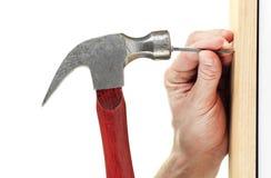 Hammer nail hit Royalty Free Stock Photography