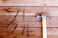 Hammer with nail Stock Images