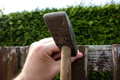 Hammer the nail into the wood with hammer royalty free stock photography