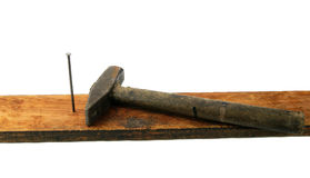 Hammer and nail on wood brick Royalty Free Stock Photography