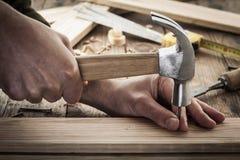 Hammer a nail Royalty Free Stock Image