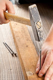 Hammer and nail woodworking Stock Photography