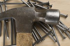 Hammer and Nails. Closeup image of hammer and nails on a piece of wood stock images