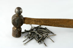 Hammer and nails. An old wooden ball peen hammer and nails Royalty Free Stock Photos