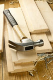 Hammer and nails. Are on a wooden planks Royalty Free Stock Image
