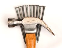 Hammer on nails Royalty Free Stock Photography