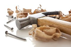 Hammer and nails. On a wood board with sawdust shavings Stock Images