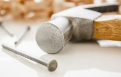 Hammer and nails. On a wood board with sawdust shavings Stock Photography