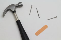 Hammer, nails, band aid Royalty Free Stock Image
