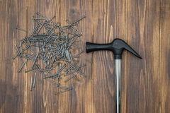 Hammer and nails on brown deck, hand made Royalty Free Stock Images