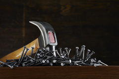 Hammer with nails Royalty Free Stock Image