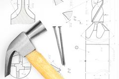 Hammer and nails on the drawing . Royalty Free Stock Photo