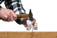 Hammer nails four. A handyman awkward trying to hammer a nail Stock Photos