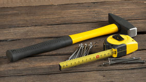 Hammer, nails and measuring tape construction Royalty Free Stock Image