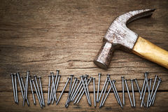 Hammer and nails. On old wood background Royalty Free Stock Photography