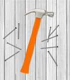 Hammer and nails over white wooden. Background Royalty Free Stock Photo