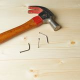 Hammer and nails over the wooden boards Stock Images