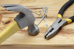 Hammer, nails and plier Royalty Free Stock Photos