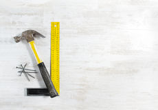 Hammer with nails, ruler. Construction tools. Royalty Free Stock Photos