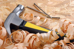 Hammer, nails, shavings Stock Photos